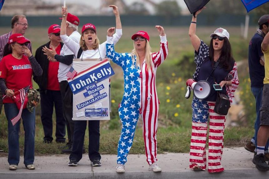 Supporters of US President Donald Trump rally for the president during his visit to see the controversial border wall prototypes on March 13, 2018 in San Diego, California.