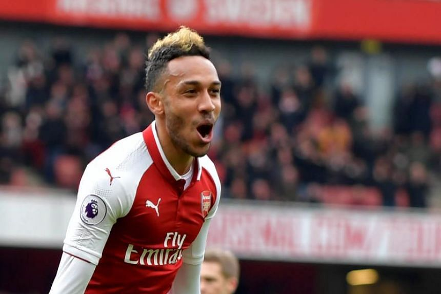Arsenal's Gabonese striker Pierre-Emerick Aubameyang celebrates scoring the team's second goal during the EPL match between Arsenal and Stoke City at the Emirates Stadium in London on April 1, 2018.