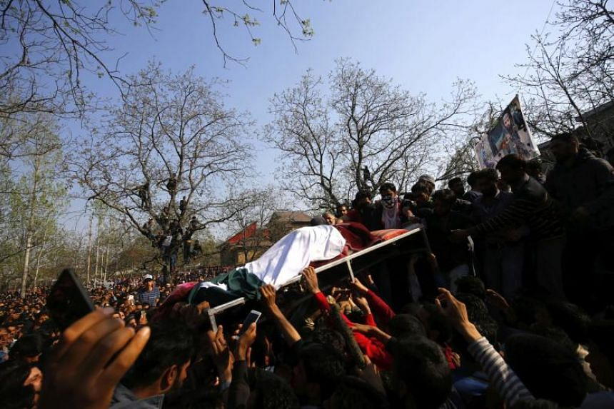 Kashmiri Muslims carry the body of a militant during his funeral procession in south Kashmir's Shopian district, some 60 kilometres from Srinagar, the summer capital of Indian Kashmir, on April 1, 2018.