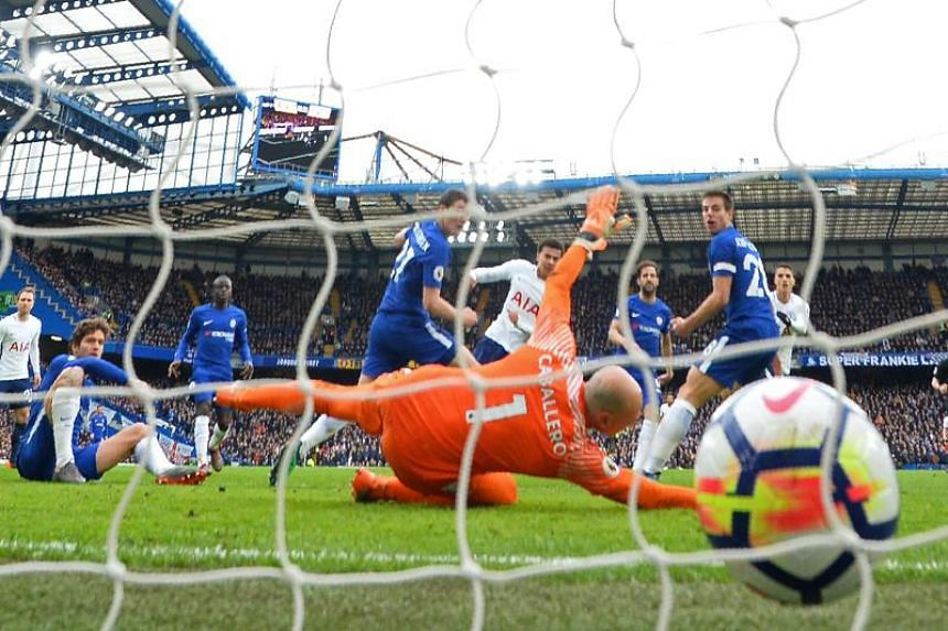 Tottenham Hotspur's English midfielder Dele Alli (centre) shoots past Chelsea's Argentinian goalkeeper Willy Caballero to score their third goal during the match between Chelsea and Tottenham Hotspur at Stamford Bridge in London on April 1, 2018.