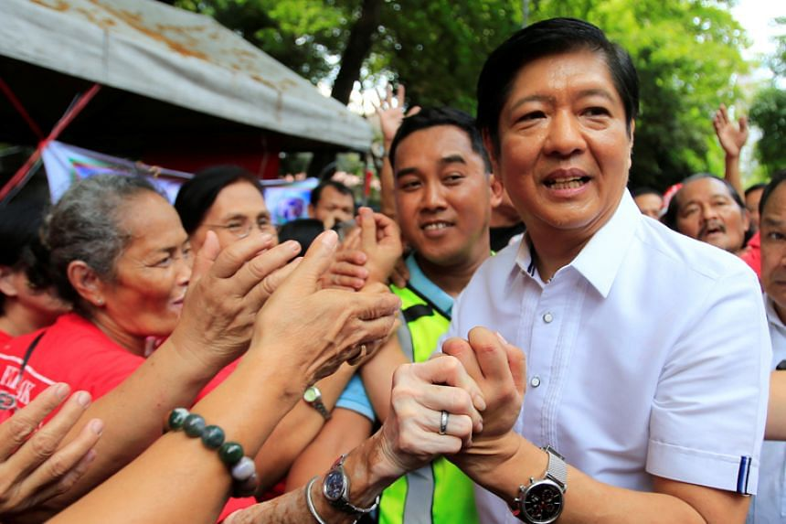 Ferdinand Marcos Jr greets his supporters outside the Supreme Court in Manila on April 2, 2018.