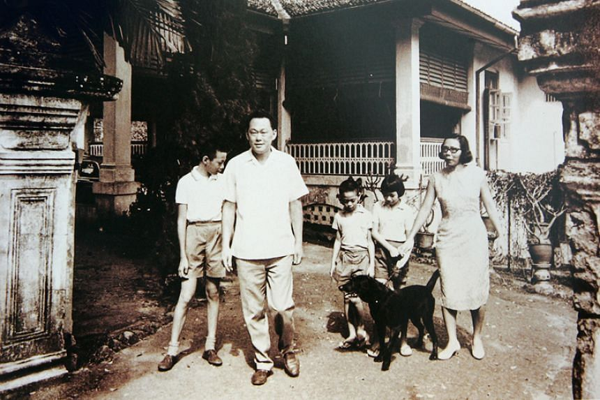 The late Mr Lee Kuan Yew and his wife Madam Kwa Geok Choo at their home at 38, Oxley Road with their three children, (from left) sons Lee Hsien Loong and Lee Hsien Yang and daughter Lee Wei Ling.