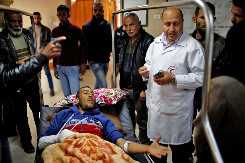 A Palestinian patient in a Gaza City hospital yesterday after he was wounded at the Israel-Gaza border, where tens of thousands of Palestinians gathered at the protest last Friday.
