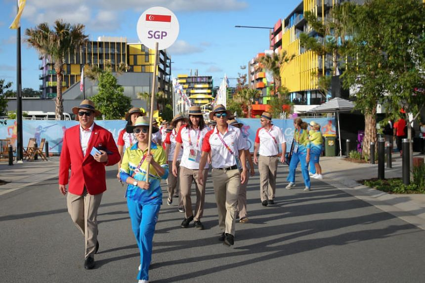 Team Singapore athletes, led by chef de mission Mark Chay (left), on their way to a welcome ceremony at the Commonwealth Games Village at Griffith University, Queensland, Australia, on April 2, 2018.