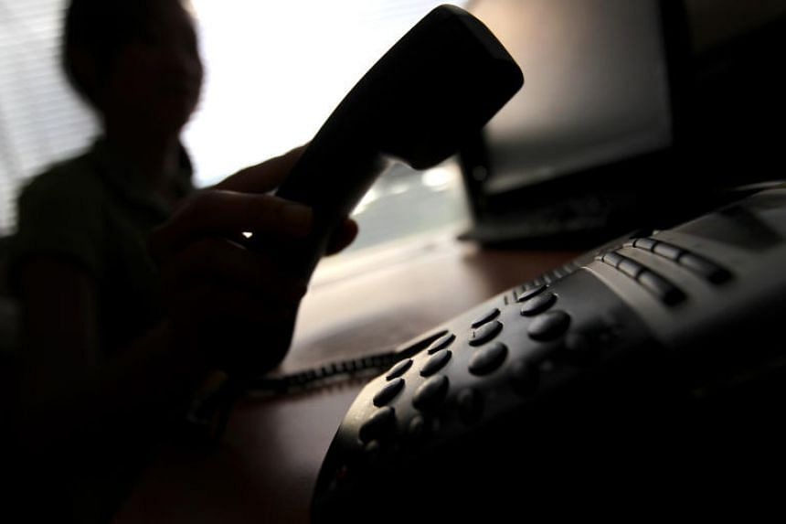 A posed photo of a person picking up the phone receiver. Scammers have been using masked numbers, claiming their targets had parcels containing illegal goods, or that they had committed criminal offences.