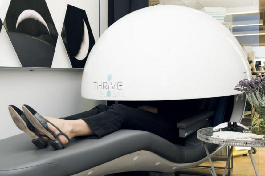 An employee sleeps in the nap room at Thrive Global, Arianna Huffington's wellness website, in New York, on March 26, 2018.
