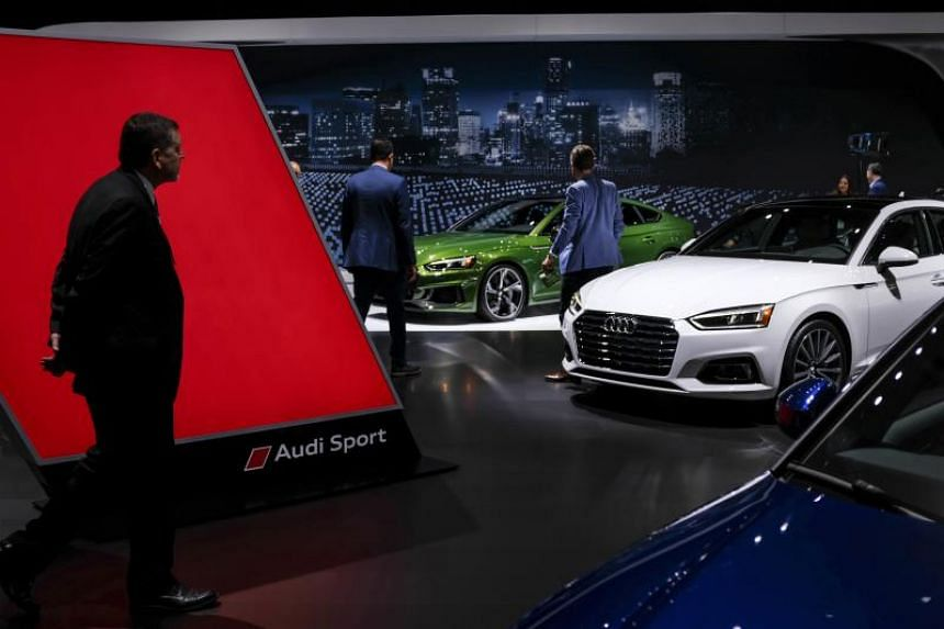 Guests walk through the Audi pavilion at the New York International Auto Show, on March 28, 2018.