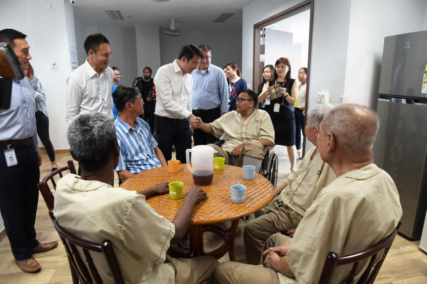 Senior Minister of State for Health and Transport Lam Pin Min greets residents at the Woodlands Care Home, on April 2, 2018.