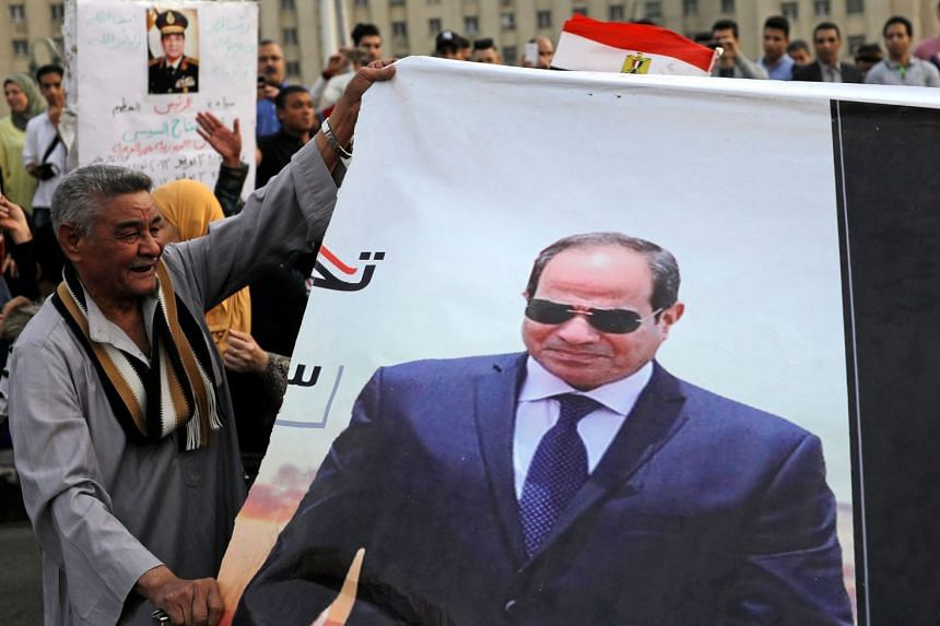 Sisi supporters celebrate in Cairo following the presidential election results.