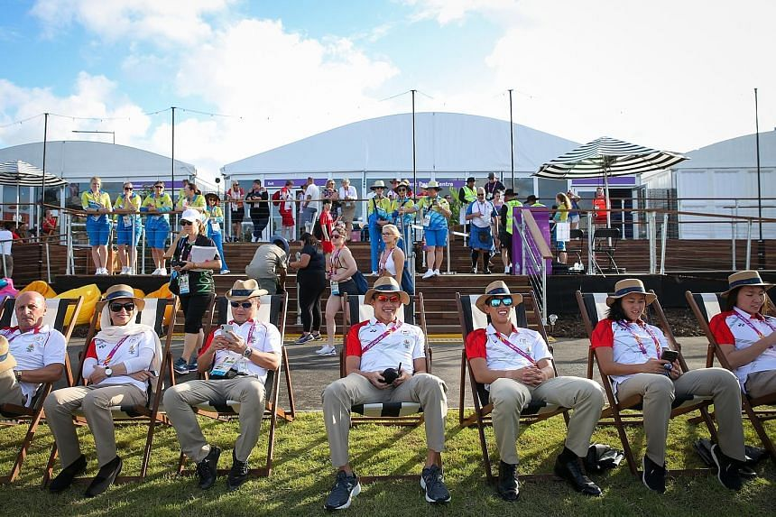 Some of the Singapore athletes and officials in a relaxed mood yesterday, before the welcome ceremony in the Commonwealth Games Village at Griffith University.