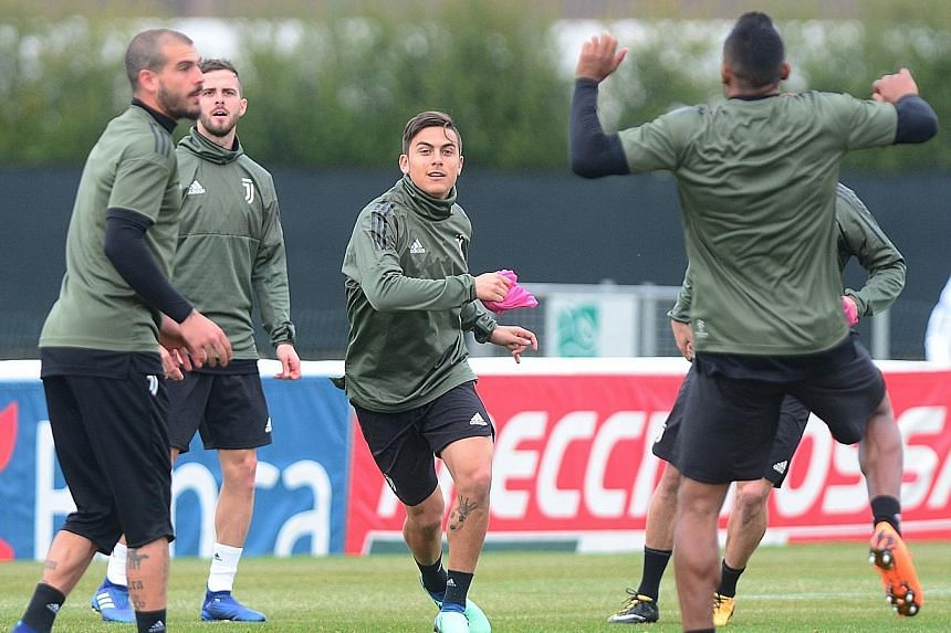 Paulo Dybala participating in a training drill at Juventus' training centre in Turin. The Argentinian may hold the key to unlocking the Real Madrid defence in their quarter-final first leg today.