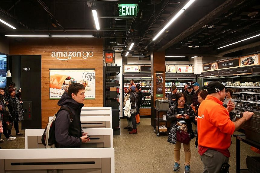 Customers browsing the Amazon Go store at Amazon's Seattle headquarters, where sensors and artificial intelligence have replaced cashiers.
