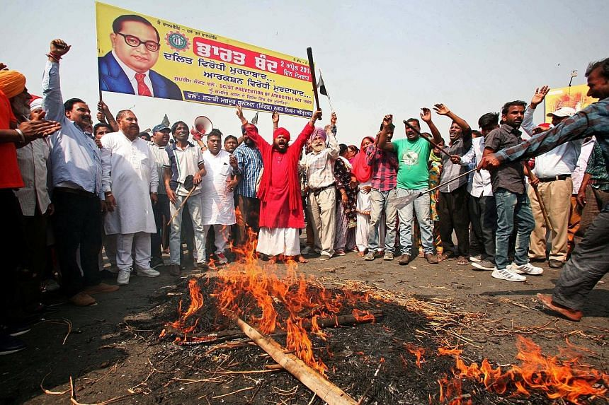 Members of the Dalit community burning an effigy depicting Indian Prime Minister Narendra Modi during a protest in Amritsar in Punjab state yesterday. The protests were also supported by many political parties and Congress.