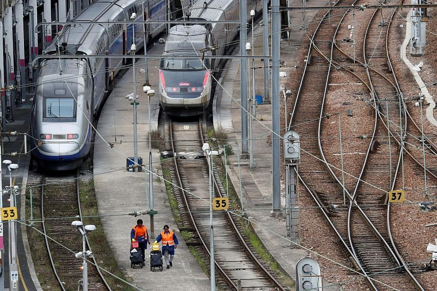 High-speed trains operated by state railway operator SNCF parked in a depot station in Charenton-le-Pont, near Paris, yesterday. The SNCF chief has warned the network's 4.5 million daily users to brace themselves for problems, as train drivers and ot