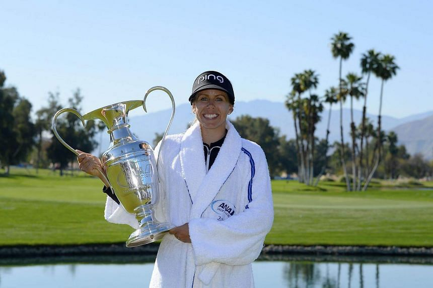 Pernilla Lindberg of Sweden poses with the winner's trophy after defeating Inbe Park of South Korea during the final round of the ANA Inspiration on April 2, 2018.