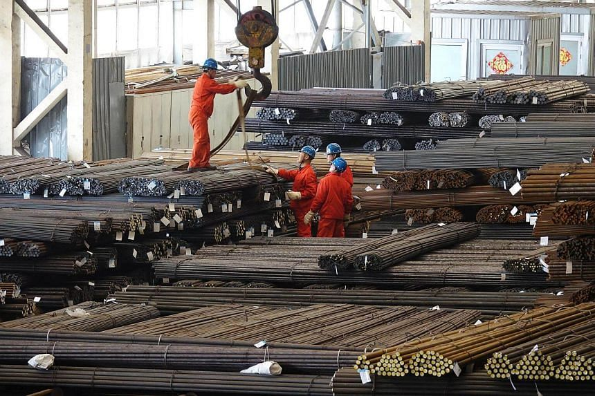 Workers transport steel bars at a plant of Dongbei Special Steel Group in Dalian, Liaoning province, China.
