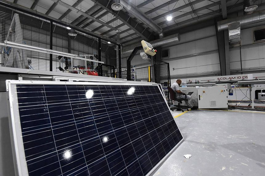 Workers at a solar panel factory in Uyayna, north of Riyadh, on March 29, 2018.