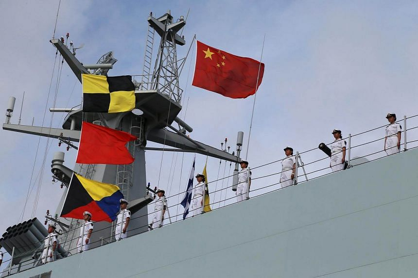A file photo of soldiers of China's People's Liberation Army (PLA) standing on a ship sailing off from a military port in Zhanjiang, Guangdong province, on July 11, 2017.