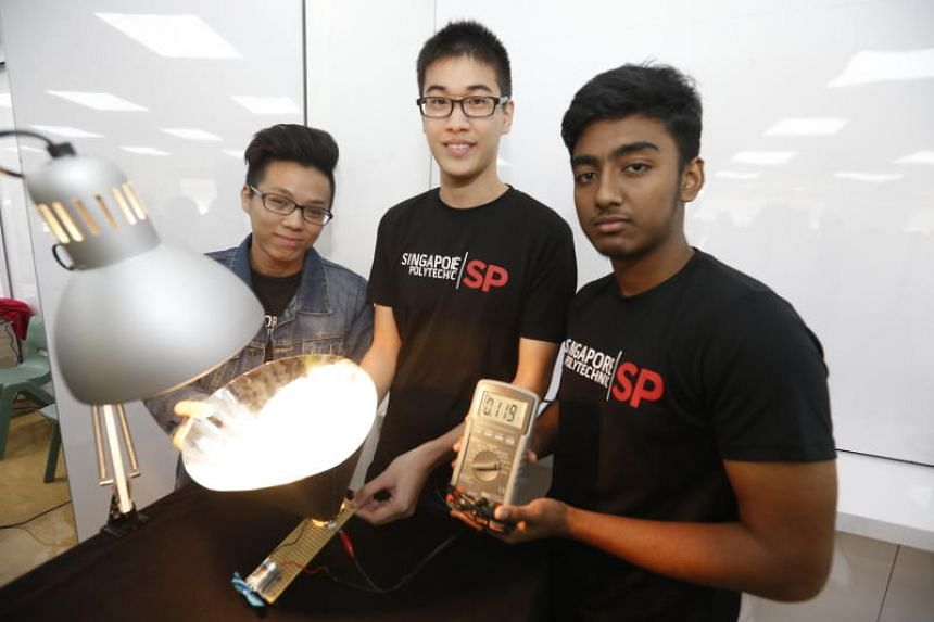 (From left) Electrical and electronic engineering students Lester Loh, 19, Ko Keng Wee, 20, and Md Tanvirul Huda, 19, from Singapore Polytechnic worked on the idea of a solar cone (Scone) which aims to increase renewable energy generation in Singapor