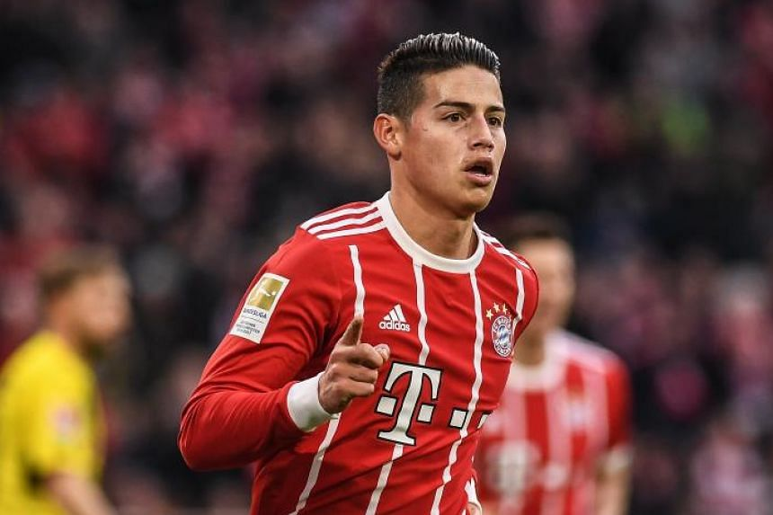 Bayern's James Rodriguez celebrates after scoring the 2-0 lead during the German Bundesliga soccer match between Bayern Munich and Borussia Dortmund in Munich, Germany, on March 31, 2018.