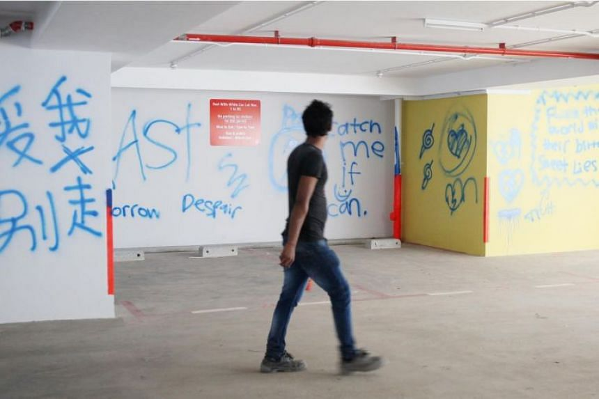 The graffiti, which was found in three storeys of the carpark, showed messages in Chinese and English, along with several symbols.