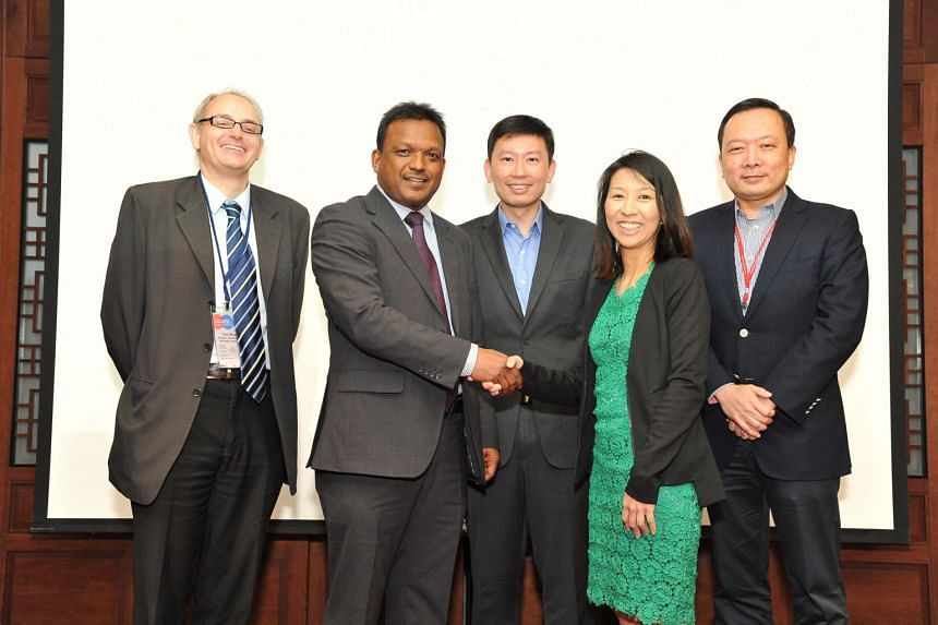 (From left) Mr Paul Bloom, director of political affairs at British High Commission; Mr Sushil Ram, programme manager at the Commonwealth Secretariat; Mr Chee Hong Tat, Senior Minister of State for Communications and Information, Ms Tan See Leng, pre