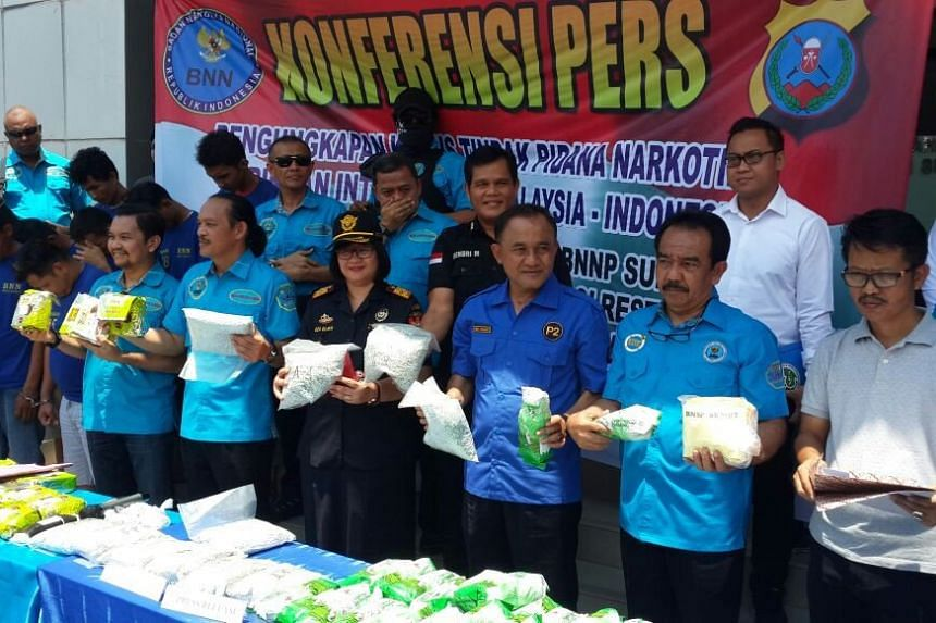 Indonesian security personnel confiscated 44.7kg of crystal methamphetamine and 58,000 ecstasy pills from Malaysia that were allegedly heading to Medan.