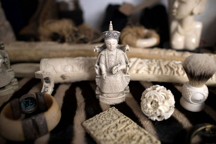 Ivory carvings that were seized at Heathrow Airport sit on display at Custom House near Heathrow in London on Nov 22, 2017.