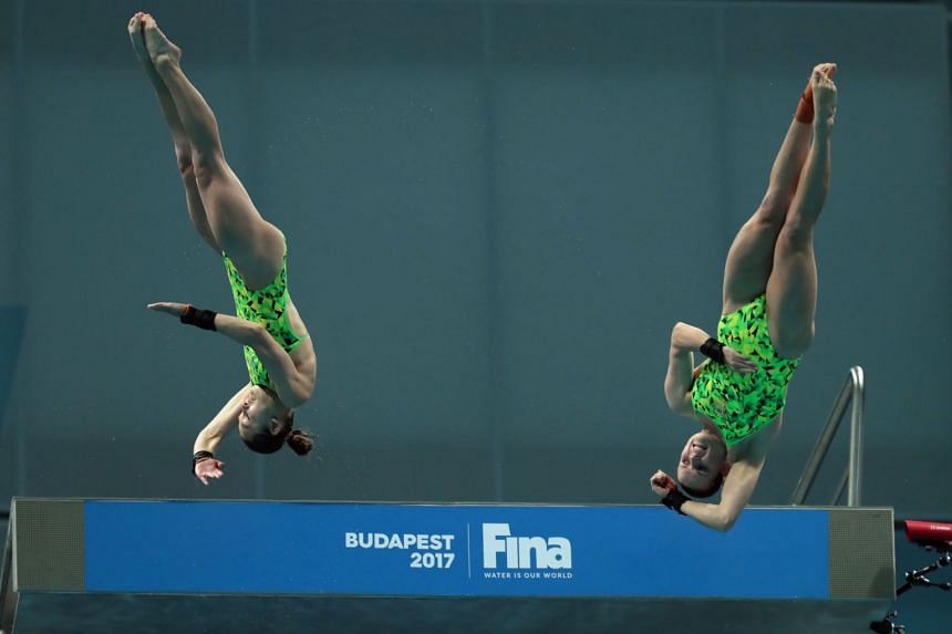Australia's Taneka Kovchenko and Melissa Wu compete in the women's 10m platform synchro final during the diving competition at the 2017 Fina World Championships in Budapest.