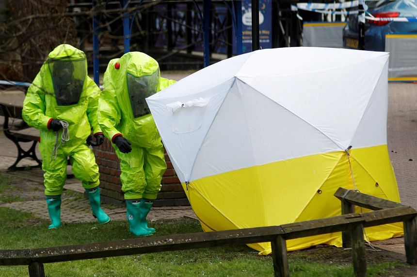 The forensic tent, covering the bench where former Russian spy Sergei Skripal and his daughter Yulia were found, is repositioned by officials in protective suits in Salisbury, Britain, on March 8, 2018.