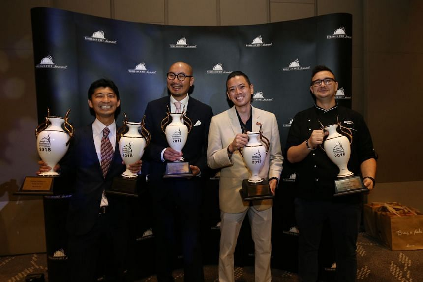 (From left) Mr Daisuke Kawai of La Terre, winner of Bar Manager of the Year; Mr Ricky Ng of Blue Lotus, winner of Restaurateur of the Year; Mr Angus Chow of Boruto, winner of Chef of the Year; and Mr Andrea De Paola of Osteria Art, winner of Rising C