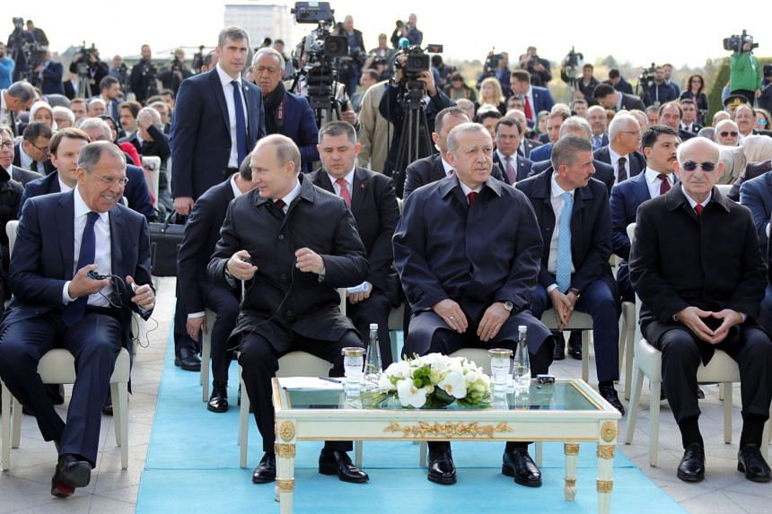 (From far left) Russian Foreign Minister Sergei Lavrov, Putin and Erdogan attend a symbolic ground-breaking ceremony for Akkuyu Nuclear Power Plant.