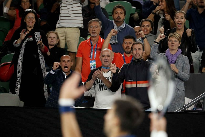 Novak Djokovic's coaches Andre Agassi and Radek Stepanek reacting during his match against South Korea's Chung Hyeon in the Australian Open fourth round on Jan 22, 2018. The Serb crashed to a shock defeat.