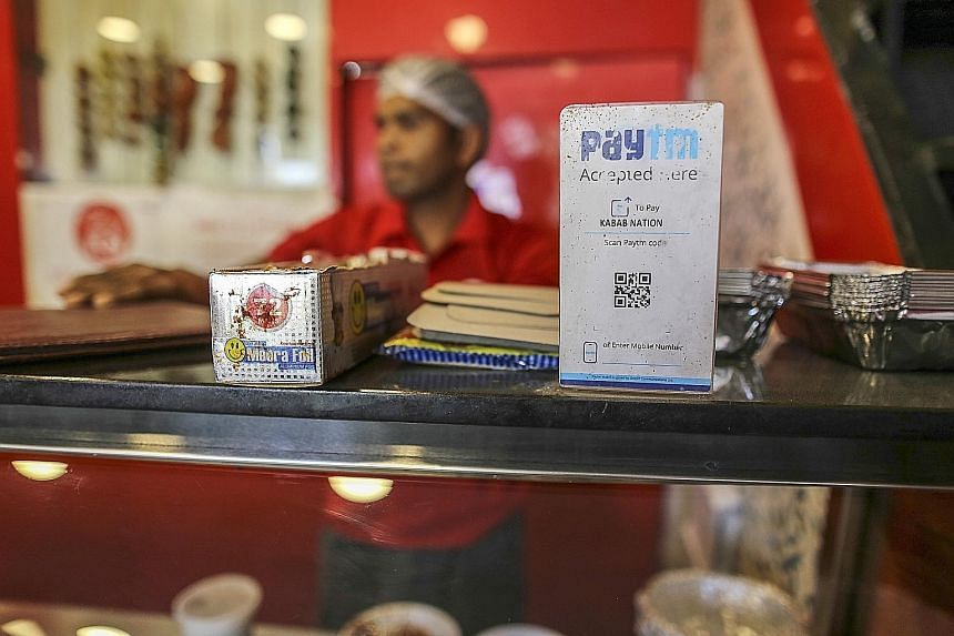 A Paytm payment sign displayed at a fast-food restaurant in Bengaluru. Paytm Mall will deploy the latest investment to beef up its technology, among other things.