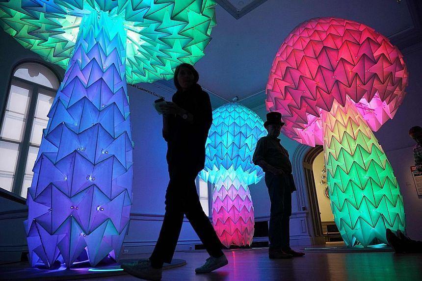 (Above) Shrumen Lumen by the Foldhaus Art Collective is a cluster of three plastic mushrooms that can heave, sigh and expand in and out when users press the pad at each mushroom's base. (Left) Truth Is Beauty by Marco Cochrane is a 5.5m-tall stainles