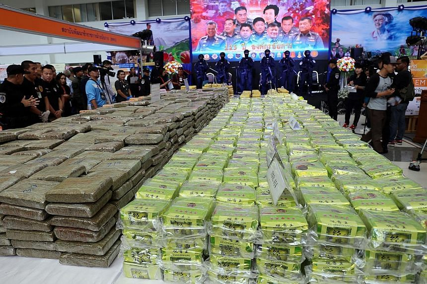 Thai police yesterday displayed the results of one of their largest crystal methamphetamine busts. Two Thais and two Malaysians were arrested in connection with the bust. The drug, known as ice, was produced in the Golden Triangle region, where the b