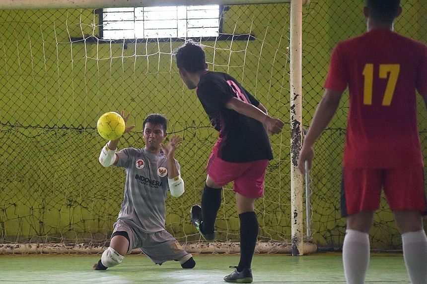 "Eman Sulaeman in action during a futsal match in Indramayu, West Java, recently. The 30-year-old Indonesian, born with no feet and just one full leg, is wowing crowds at home and abroad with his ""cat-like"" reflexes, and knocking home a powerful messa"