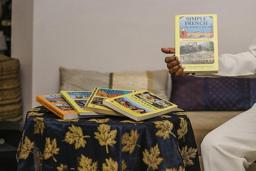 Dr Sivam with the self-study language handbooks that he came up with at the Europhone Institute, which offered languages such as French and Vietnamese. Dr K. P. Sivam at his home in Serangoon with a Mandarin language kit comprising guides, textbooks