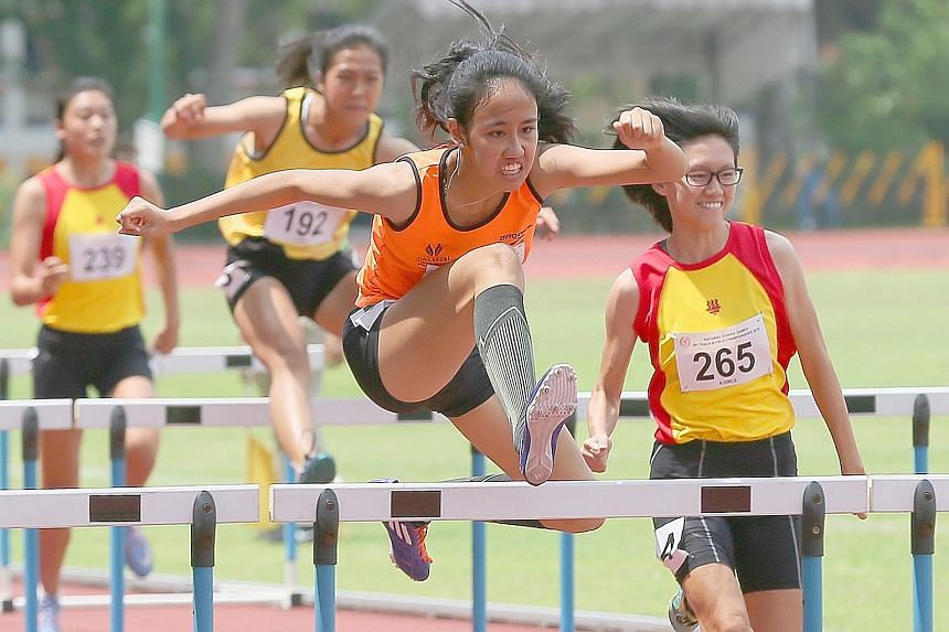 Left: Chong Wei Guan of the Singapore Sports School says his record-breaking feat was the result of hard work put in with his coach, Pedro Cunha. Right: Tia Louise Rozario of the Singapore Sports School retaining the girls' A Division 110m hurdles in