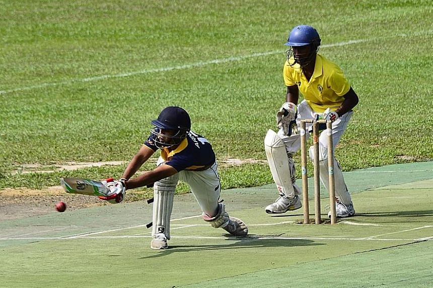 Victoria School wicket-keeper Joshua Pooranakaran follows the flight of the ball as Arnaav Chabria of Anglo-Chinese School (Independent) bats during the B Division cricket final at the Singapore Indian Association ground yesterday. The vice-captain h