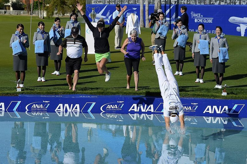 Pernilla Lindberg's caddie takes the perfect dive into Poppie's Pond, as the Swedish golfer and her parents Jan and Gunilla follow suit after she won the ANA Inspiration. She edged out seven-time Major winner Park In Bee in a marathon eight-hole play