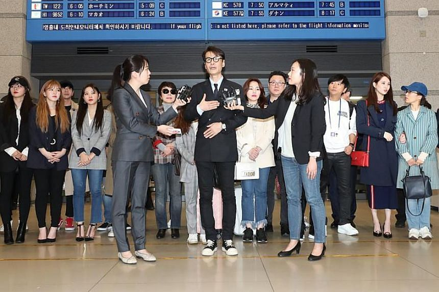 South Korean artists hold a press conference at Incheon International Airport as they return home after two concerts in the North Korean capital Pyongyang, the first such event since 2005.