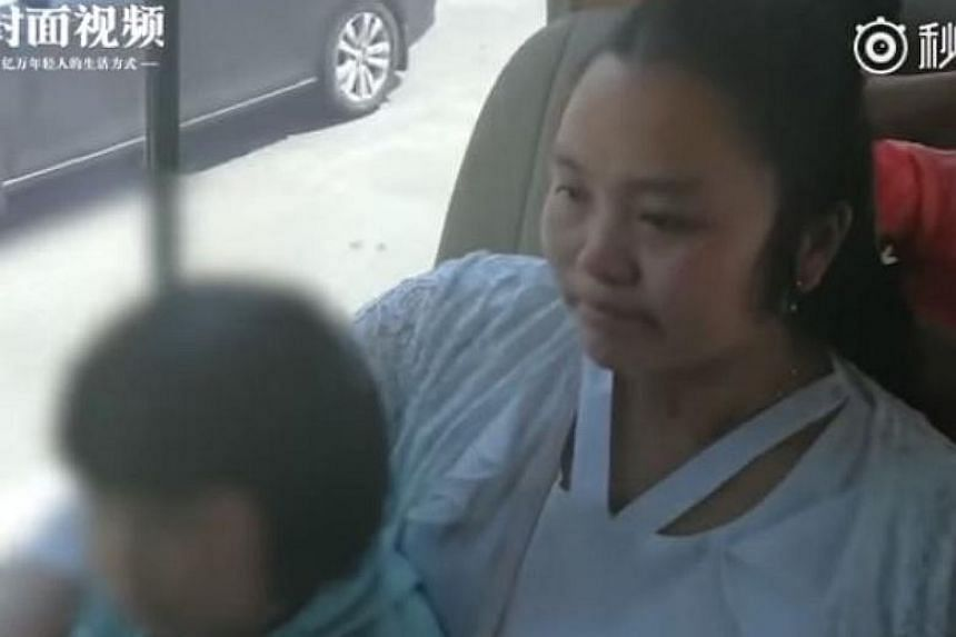Kangying, 28, was flown to Chengdu along with her own daughter to meet her biological parents.