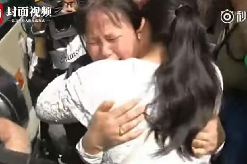 Ms Liu Dengying giving her daughter Kangying a hug after being apart for 24 years. Ms Liu and her husband were tending their fruit stall in Chengdu on Jan 8, 1994 when their then three-year-old daughter went missing.