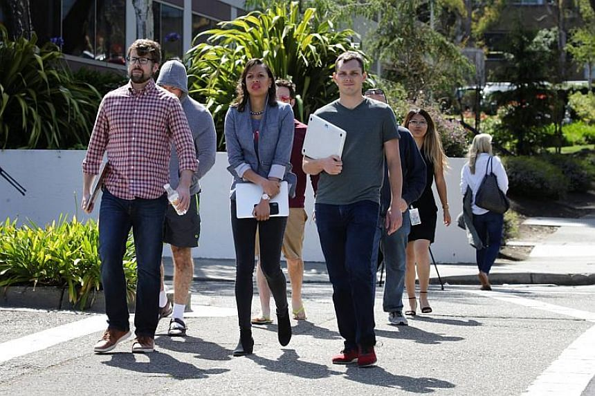 YouTube employees are seen walking away from the YouTube headquarters following an active shooter situation in San Bruno, California on April 3, 2018.