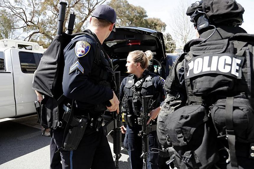 Police officers seen outside the YouTube headquarters following a shooting in San Bruno, California on April 3, 2018.
