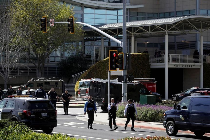 Policemen walking outside the YouTube headquarters on April 3, 2018, in San Bruno, California, following a shooting incident.