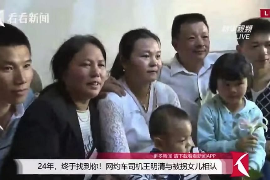 Mr Wang Mingqing (third from right) and his wife Liu Dengying (second from left) were finally reunited with their daughter Qifeng (centre), now known as Kangying, who went missing in 1994.