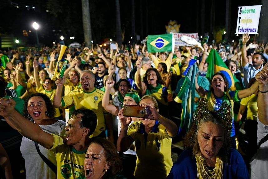 Demonstrators call for former Brazil president Luiz Inacio Lula daSilva's arrest one day before the supreme court issues its final decision, in Rio de Janeiro, Brazil on April 3, 2018.