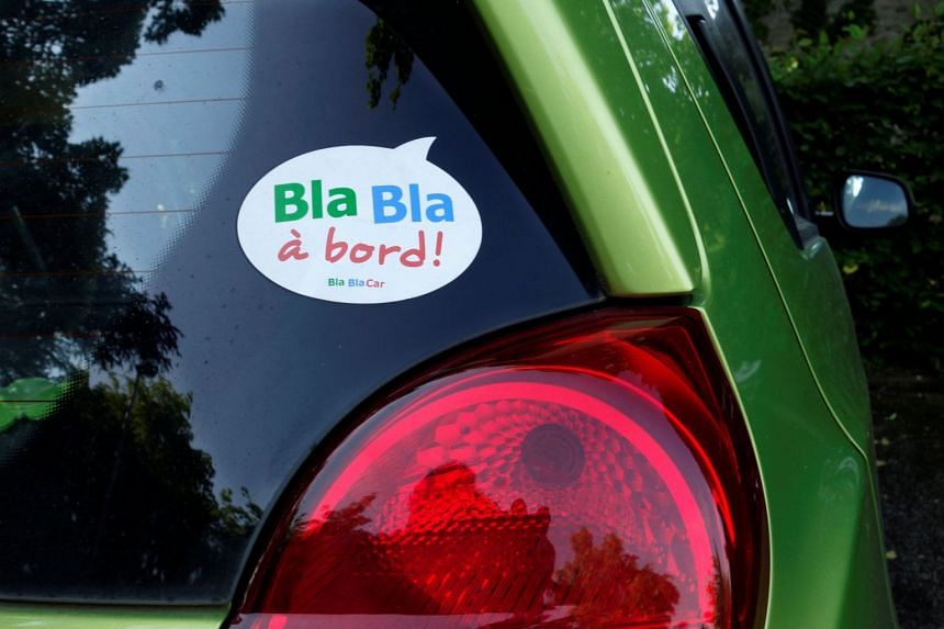 A sticker of French ride-sharing start-up BlaBlaCar is seen on a car at Le Coudray-Montceaux, near Paris on May 27, 2017.